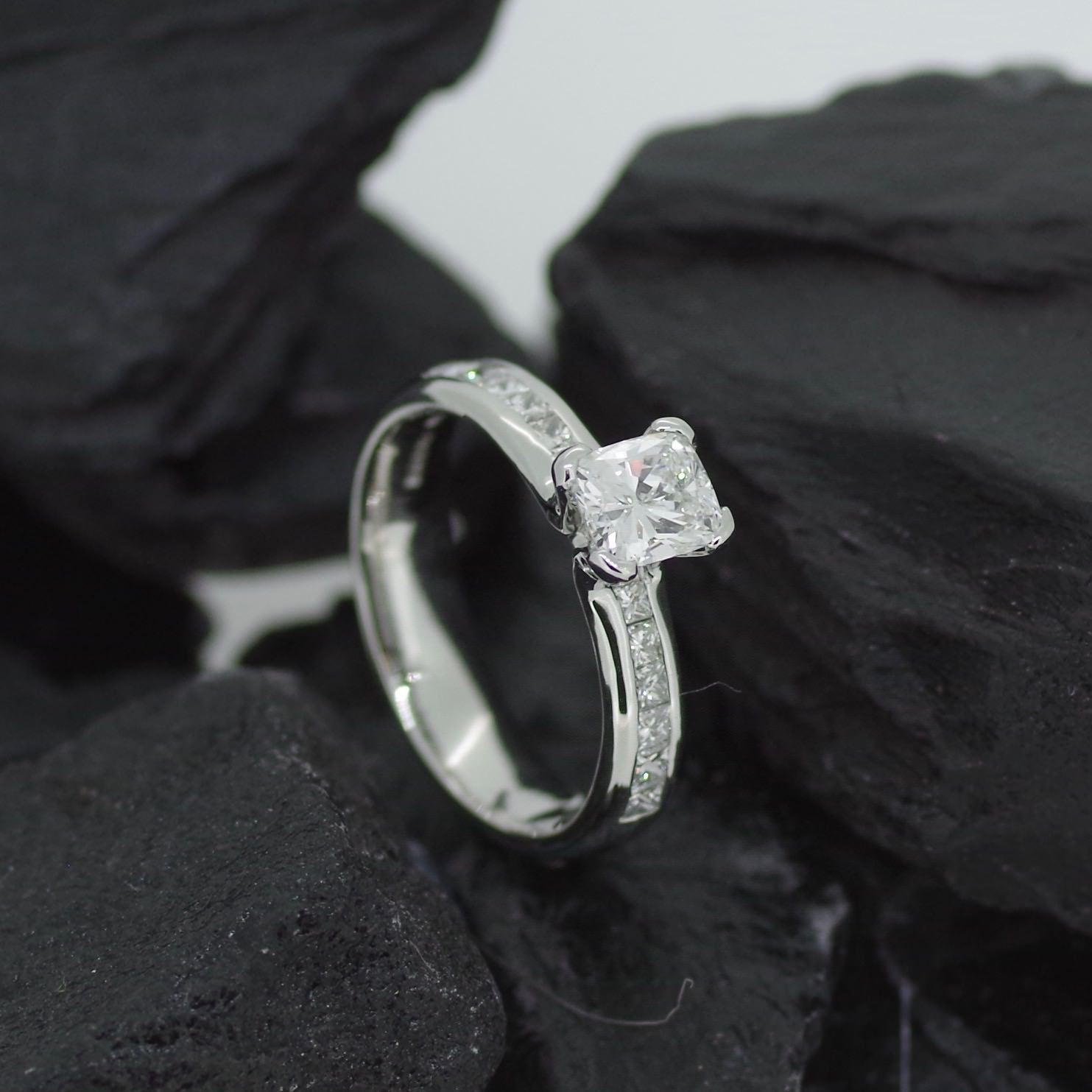 Platinum Jubilee ring set with one 0.70ct custion cut Diamond and sixteen princess cut Diamonds (ER013)