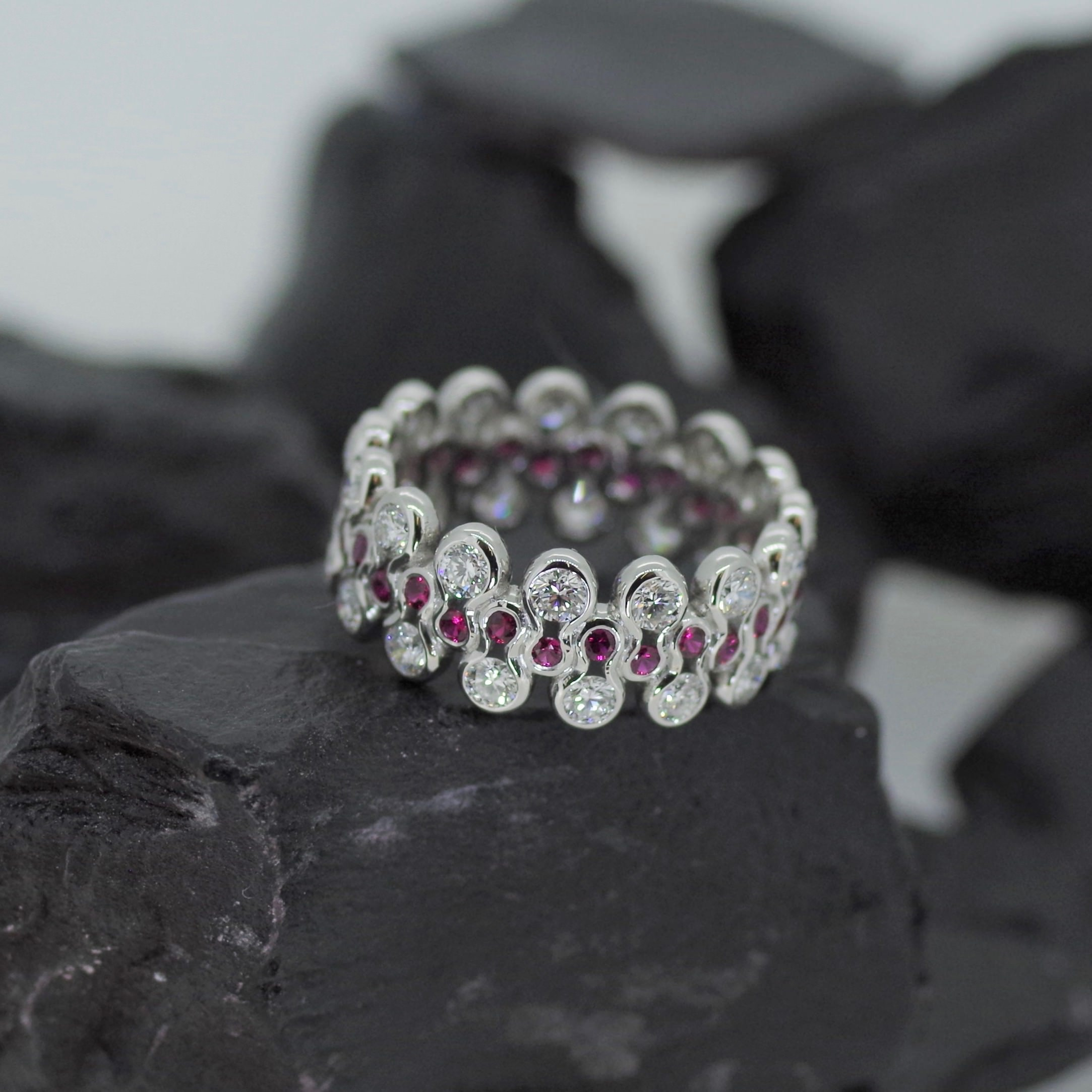 Platinum Eight ring set with sixty Diamonds and Rubies (ref ET008)