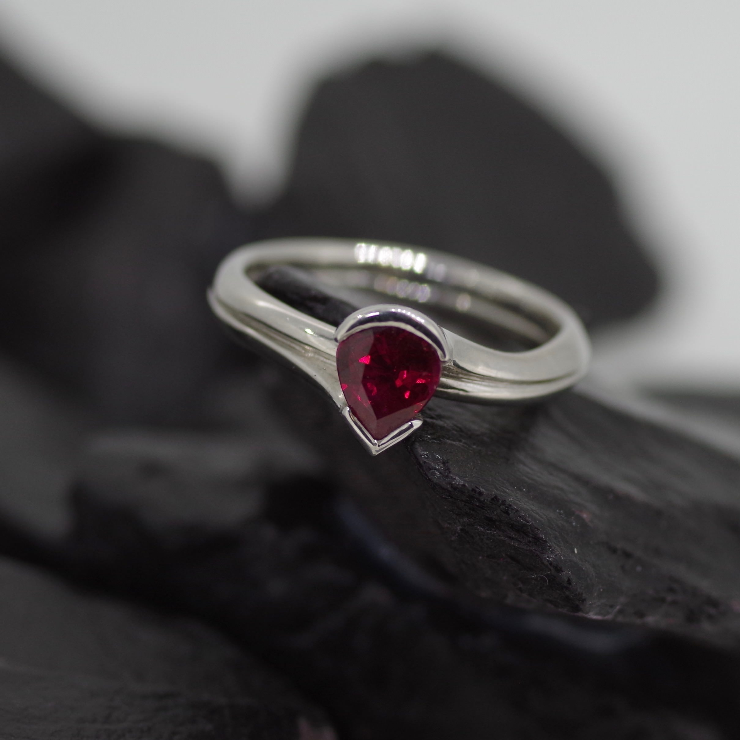 Platinum Spirala ring set with one very rich red 0.83ct pear cut Ruby. (ER016)