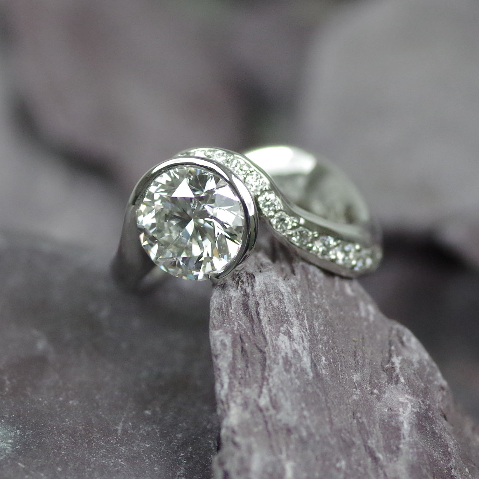 Platinum ring set with one 2.13ct brilliant cut Diamond and fifteen flanking Diamonds (refER004)