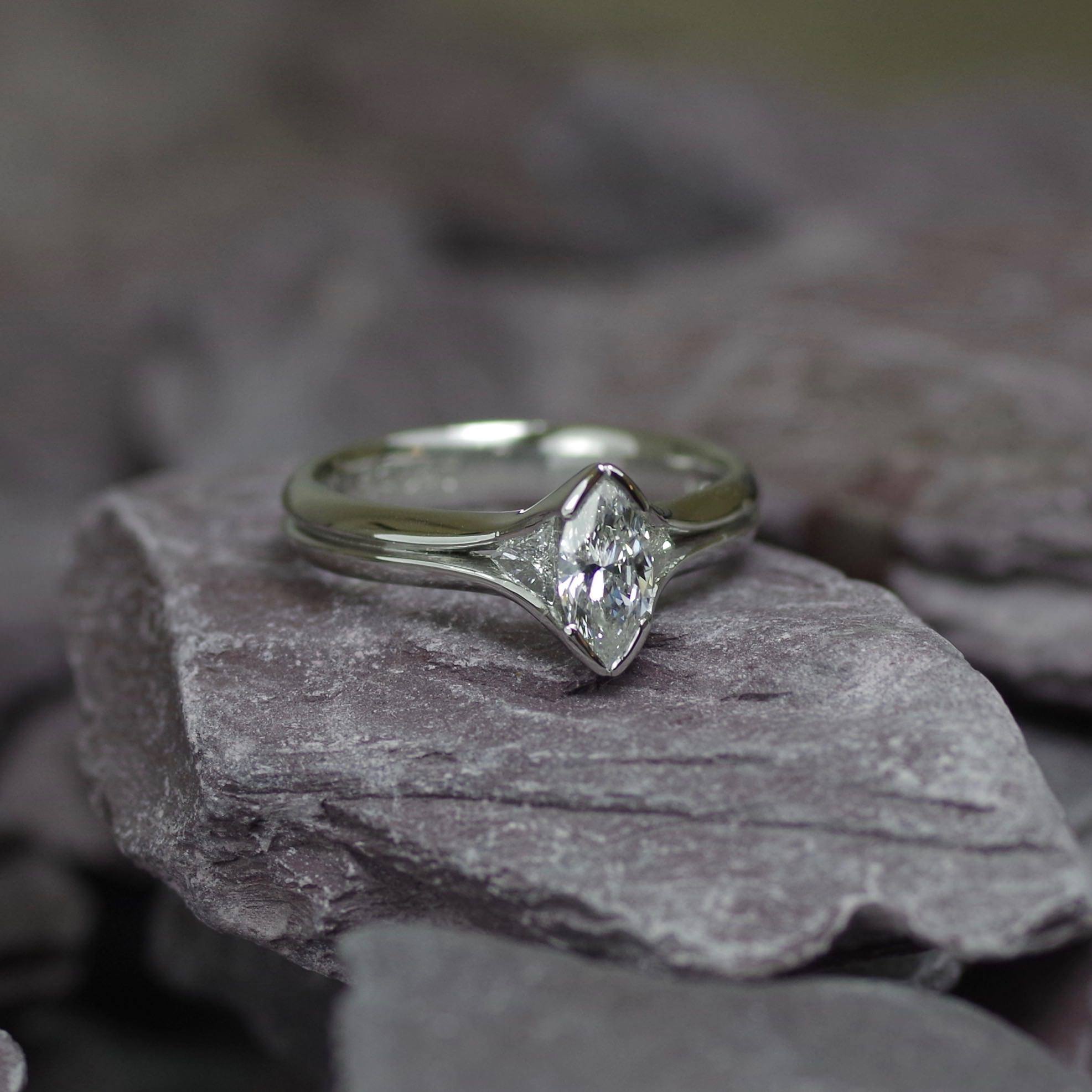 Platinum ring set with one 0.50ct marquise cut Diamond and two flanking trillion cut Diamonds. (ER014)