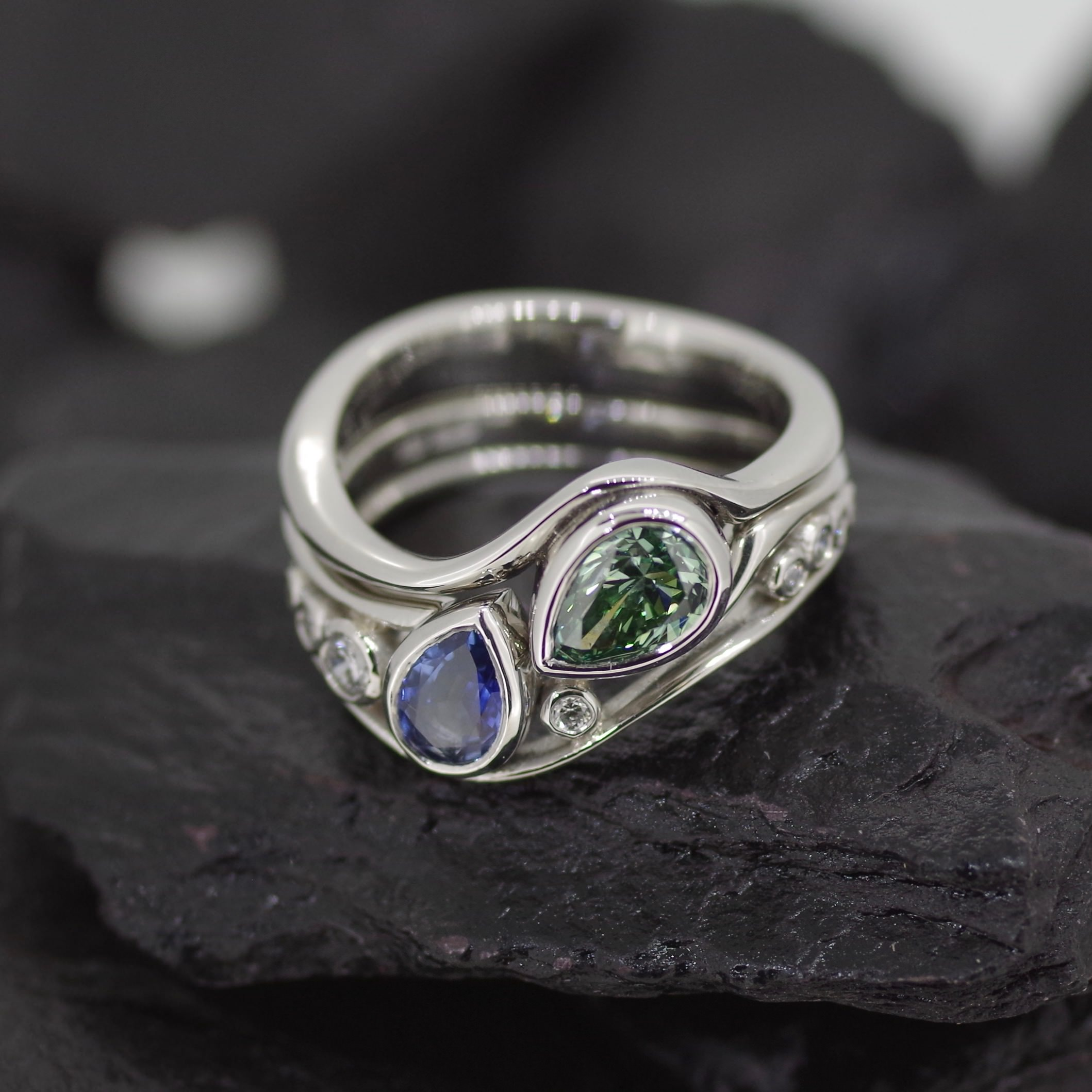 Platinum two part ring, 1st ring set with 0.69ct pear cut Green Diamond, 2nd ring set with 0.60ct pear cut sapphire and flanking Diamonds. (ER010)